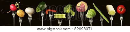 Variation of fresh vegetables on a black background,