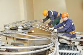 Electricians lineman repairman worker or installers at huge power industrial transformer installation work poster