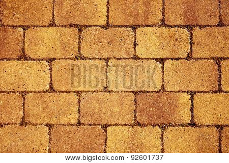 closeup of a orange stone wall or stone pavement background