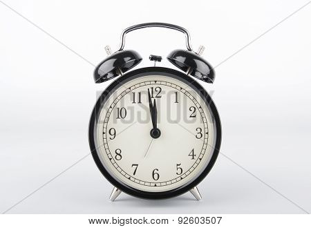 Two Minutes To Twelve O'clock. Alarm Clock.
