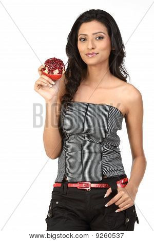 Teenage girl with pomegranate