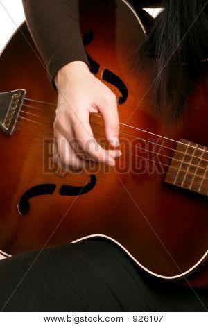 Playing Strumming A Guitar
