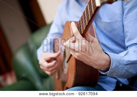 Man playing classic, acoustic guitar