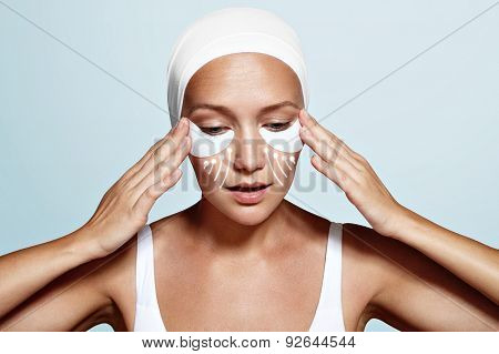 beauty woman with eye patches and lines showing an effect of poster