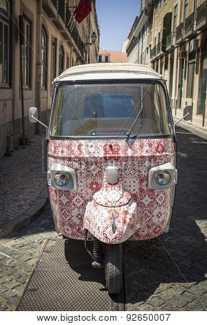 Colourful patterned Tuk Tuk in Lisbon