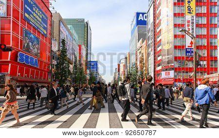 People crossing the street at Tokyo's Akihabara area