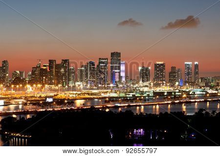 Miami Skyline Lights Up At Dusk Against Pink Sunset