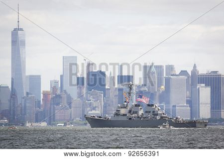 STATEN ISLAND, NY - MAY 20 2015: USS Barry (DDG 52) passes the Freedom Tower of One World Trade Center in Lower Manhattan along the Hudson River during the Parade of Ships, which begins Fleet Week.