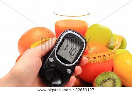 Glucometer in hand. fresh fruits dumbbells for using in fitness tape measure and glass of juice concept for diabetes slimming healthy nutrition and strengthening immunity poster