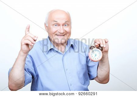 Refreshing morning. Brisk grandfather  holding the alarm clock and pointing his index finger up while expressing joy. poster