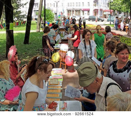Visitors Take A Good Look At Books On The Stalls