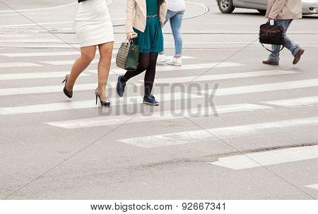 Women's Legs On A Pedestrian Crossing Closeup