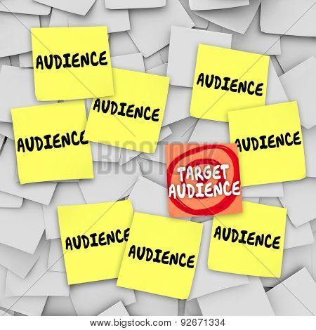 Target Audience words on a sticky note with bulls-eye zeroed in on the group of customers or readers best meeting your desired demographics