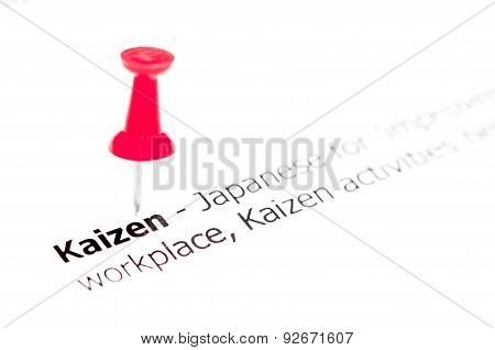 Word Kaizen Pinned On White Paper With Red Pushpin