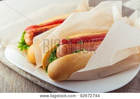 Hotdogs On Wooden Table