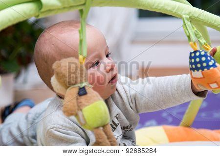 Portrait Of A Cheerful Newborn .