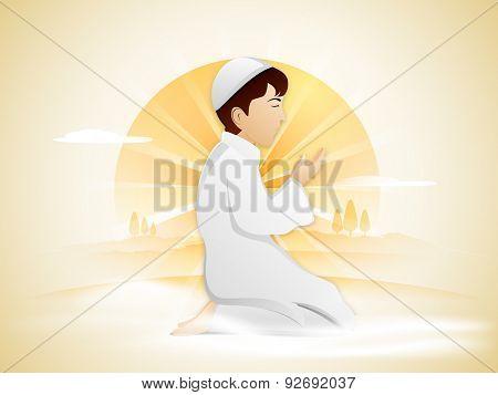 Religious Muslim boy in traditional outfits, praying Namaz (Islamic Prayer) on nature background for holy month of Muslim community, Ramadan Kareem celebration.  poster