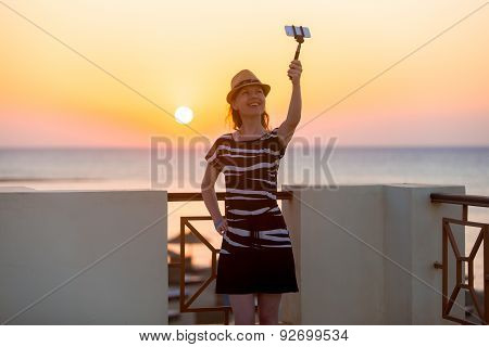 Young Woman Taking Selfie With Sea Sunset