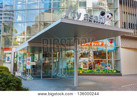 Tokyo, Japan - November 28 2015: T.v. Asahi Building Situated On The Opposite Side Of Mori Tower Bui
