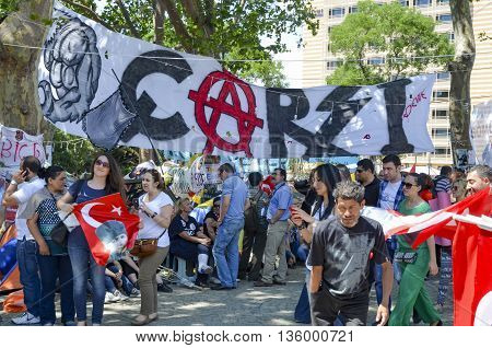 Istanbul Turkey - June 9 2013: Besiktas fan group who support the Gezi Park protest poster's Bazaar. A wave of demonstrations and civil unrest in Turkey began on 28 May 2013 initially to contest the urban development plan for Istanbul's Taksim Gezi Park.
