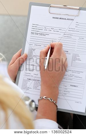 Female Doctor Hold Clipboard Pad