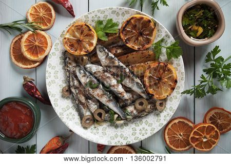 Grilled sardine fish with lemon and roasted potato