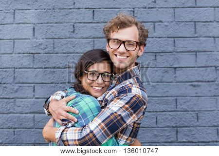 Affectionate young couple embracing each other