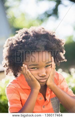 Boy feels sad in a park