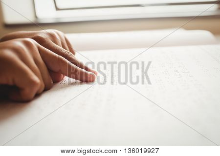 Child using braille to read at school