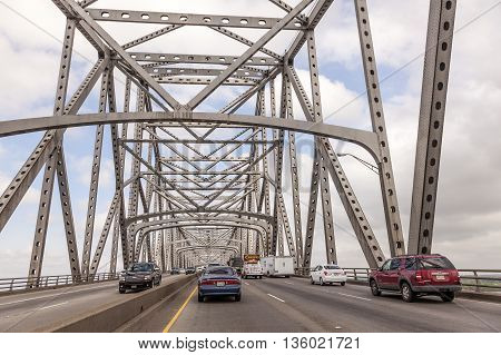 WESTLAKE USA - APR 15: Traffic on the historic Calcasieu River iron bridge from 1951. April 15 2016 in Westlake Louisiana United States