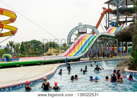 Kanchanaburi Thailand - March 30 2016: People enjoy playing in new waterpark open in Kanchanaburi province Thailand