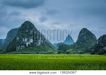 The karst mountains and rural scenery in the mist