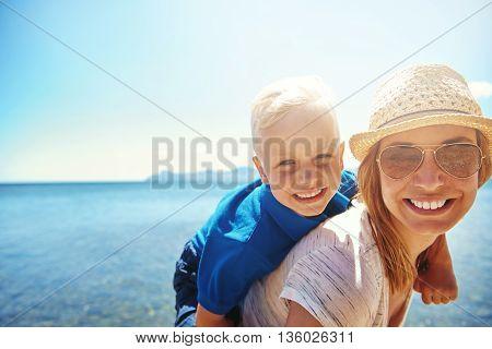 Happy Little Boy Getting A Piggy Back Ride