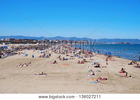 VALENCIA, SPAIN - JUNE 22: Sunbathers at El Cabanyal and La Malvarrosa beaches on June 22, 2016 in Valencia, Spain. These are the main beaches in the capital of the Valencian Community