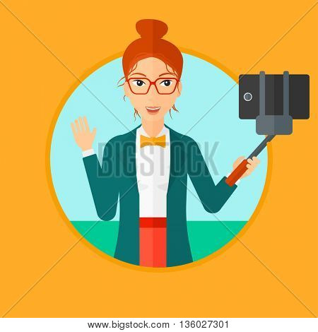 Smiling woman making selfie with a selfie-stick. Woman taking photo with cellphone. Young woman taking selfie and waving. Vector flat design illustration in the circle isolated on background.