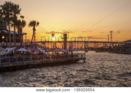 KEMAH TX USA - APR 14 2016: Sunset at the Kemah Boardwalk. Kemah is a famous resort in the Galveston Bay area. Texas United States