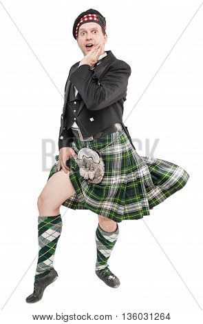 Scottish Man In Traditional National Costume With Blowing Kilt