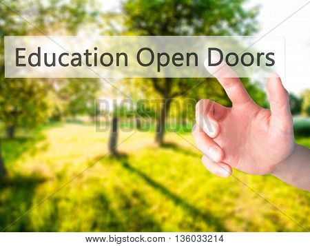 Education Open Doors - Hand Pressing A Button On Blurred Background Concept On Visual Screen.