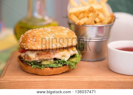 Burger with chicken cutlet and fries. Unhealthy food