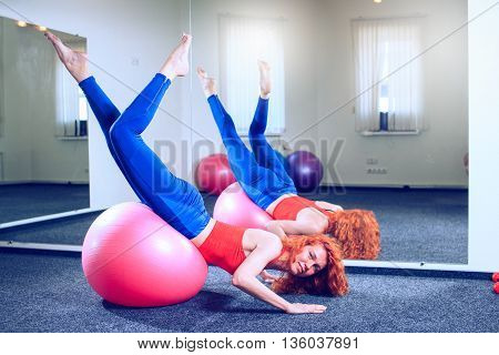 fitness sport training and people concept - smiling woman doing exercises on mat in gym
