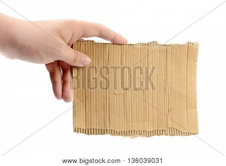 hand holding empty piece of cardboard isolated on white