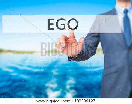Ego - Businessman Hand Pressing Button On Touch Screen Interface.