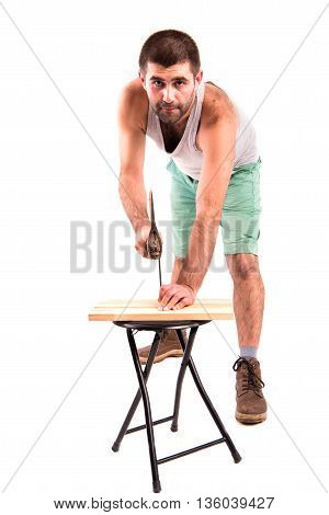 Man Hammers A Nail Into A Plank
