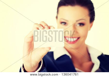 Beautiful smiling businesswoman with businesscard.