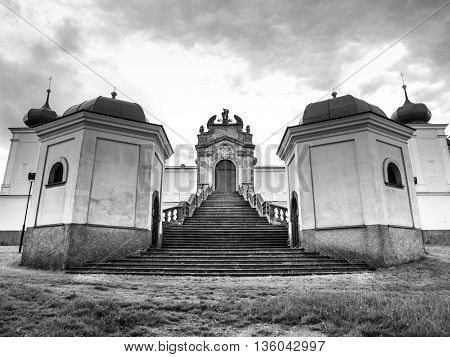 Beautiful staircase and entrance gate to Monastery and place of pilgrimage on Mountain of Holy Mother, Horni Hedec, Czech Republic . Black and white image.