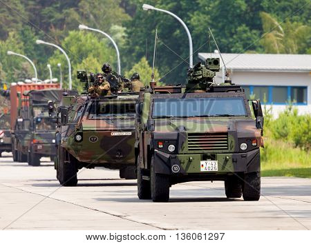 BURG / GERMANY - JUNE 25 2016: german military army convoy drives on open day in barrack burg / germany at june 25 2016