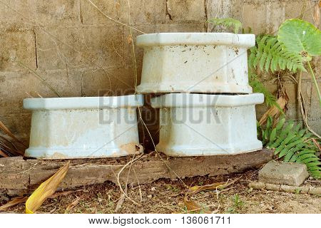 Old toilets with old wall pattern background