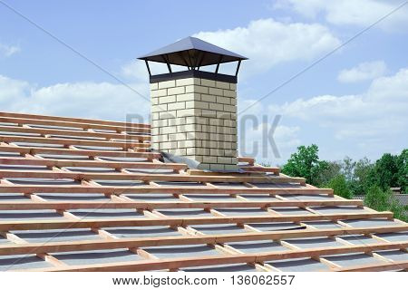 chimney with light brick newly built cottage with no roof tiles
