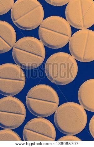 Strewn pills on dark background. Close- up photo