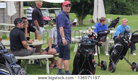 26TH JUNE 2016, BLACKNEST, ENGLAND: A group of golfers  having a drink after playing a round of golf at blacknest golf club in england, 26th june 2016